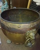 A Large Brass and Copper Jardiniere, circa late 19th century, Having lion mask ring handles,