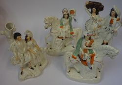 Four Victorian Staffordshire Flatback Figures, one example modelled as a married couple, 30cm