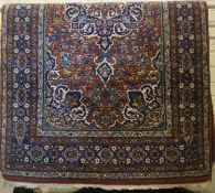 A Fine Isfahan Rug, Decorated with allover multi coloured geometric and floral motifs, on a brown