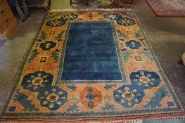 A Yagcibedir (Turkish) Rug, Decorated with geometric medallions, on an orange and blue ground,