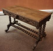 A Carved Oak Hall / Side Table, circa early 20th century, Having two drawers, decorated with