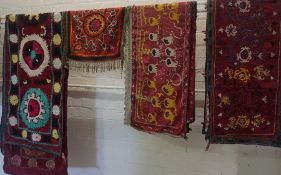 Four Old Suzani Embroidered on Silk Throws, Decorated with assorted floral and geometric panels,