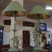 A Pair of Green Painted Candle Lamps, Fitted for electricity, 47cm high, with shades, (2)