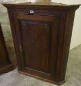 A George III Oak Corner Cupboard, Having a cupboard door enclosing a shelved interior, 94cm high,