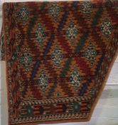 An Azmilk Rug, Decorated with allover multi coloured geometric motifs, on a brown ground, 110cm x