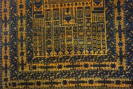 An Afghan Rug, Having geometric decoration, on a blue and orange ground, 143cm x 90cm, also with a