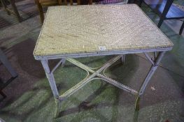 An Antique French White Painted Rattan Table, 73cm high, 71cm wide, 55cm deep