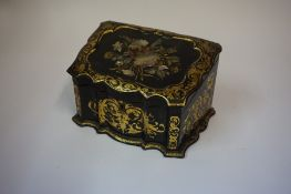 A Victorian Black Lacquered Papier Mache Stationery Box, Having a hinged top enclosing a fitted