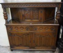 A Jacobean Style Oak Court Cupboard, circa 20th century, Having a cupboard door to the top,