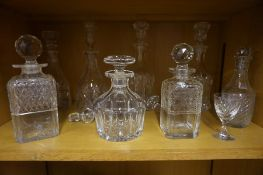 Eight Various Crystal and Glass Decanters, with various stoppers, (11)