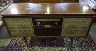 A Vintage Radiogram by Bush, 72cm high, 122cm wide, 40cm deep