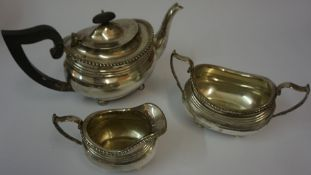 A Silver Three Piece Tea Service, Hallmarks for London, makers marks and date mark indistinct,