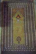 A Pakistani Prayer Rug, Having geometric motifs, on a beige ground, 158cm x 96cm