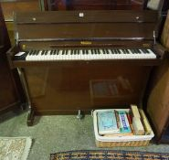 The Eavestaff Minipiano, cased in mahogany, 86cm high, 121cm wide, 45cm deep, with a quantity of