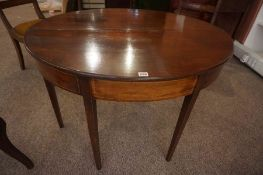 A Georgian Mahogany Demi Lune Tea Table, Having a fold over top, raised on plain legs, 70cm high,