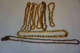 Seven Strings of Costume Amber Coloured Bead Necklaces, Various sizes, (7)