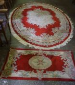 A Floral Decorated Rug, Decorated with floral panels on a red ground, 283cm x 171cm, also with a