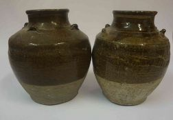 A Pair of Glazed Pottery Oviform Vases, 25cm high, (2)