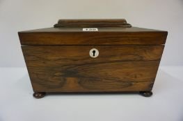 A Regency Rosewood Sarcophagus Tea Caddy, circa early 19th century, Enclosing a fitted interior