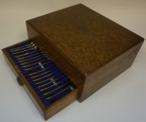 A Part Canteen of Cutlery, in a fitted oak case, with pull out drawer, having label and stamped to