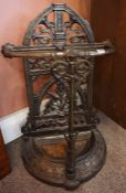A Victorian Style Cast Iron Stick Stand, Decorated with scrolls and swags, with drip tray, 78cm high