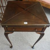 A Mahogany Envelope Card Table, circa early 20th century, Having a revolving top, enclosing a