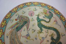 A Chinese Famille Rose Plate, circa late 19th century, Decorated with a polychrome four claw