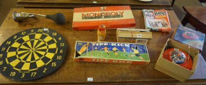 A Mixed Lot of Vintage Games, to include a battery powered flying saucer, boxed, the Beatles jigsaw,