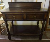 An Oak Hall Table / Side Table, Having a pediment top, above two small drawers and under tier,