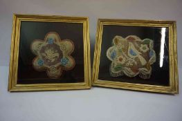 Two Victorian Beadwork Cushions, approximately 23cm x 25cm, both enclosed in glazed wall mounting