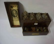 A Georgian Mahogany and Brass Mounted Apothecary Box, Enclosing eight assorted glass bottles to
