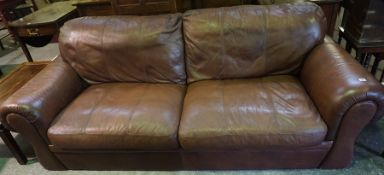 A Brown Leather Sofa, approximately 227cm wide