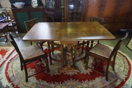 A Vintage Oak Drop Leaf Table, 76cm high, 148cm long, 92cm wide, also with four chairs, (5)