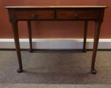 A Regency Design Mahogany Writing Table, circa mid 19th century, Having two small drawers, with