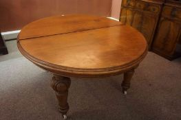 A Victorian Mahogany D End Extending Dining Table, Having one additional leaf, raised on carved