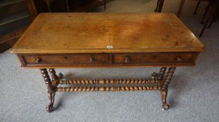 A Victorian Walnut Writing Table, Having two small drawers, raised on barley twist column supports
