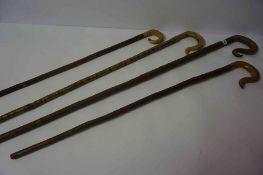 Four Shepherds Crooks / Walking Sticks, 82cm, 93cm, 144cm and 183cm long, three examples having horn
