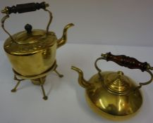 A Vintage Brass Toddy Kettle, Having an amber coloured glass handle, 22cm high, also with a brass