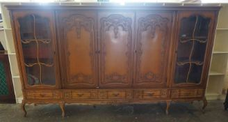 A Large Antique Style Bookcase by Schlingmann Wartmobel of Germany, Having three panelled doors,