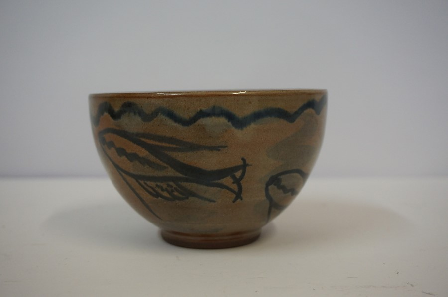 Lot 41 - Studio Pottery Bowl, circa 1960s, Decorated with allover panels of fish on a glazed brown ground,