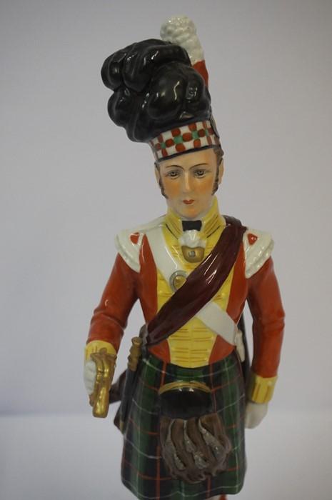 Lot 30 - Sitzendorf Porcelain Figure of a Seaforth Highlander, stamped to underside, 29cm high