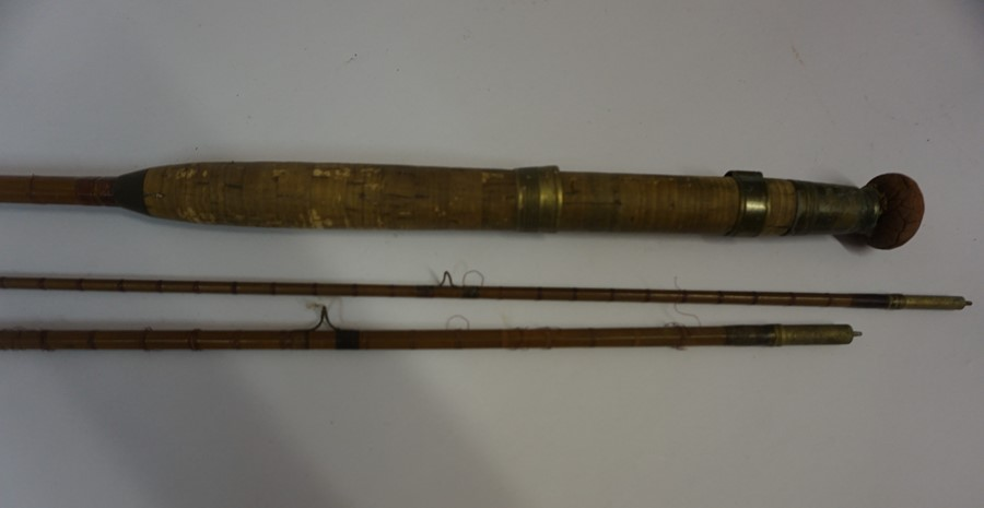 Lot 58 - Three Vintage Two and Three Piece Fishing Rods, with canvas carry bags, (3)