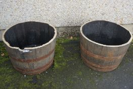 A Pair of Whisky Half Metal Bound Barrels, Used as planters, 44cm high, 64cm wide, (2)