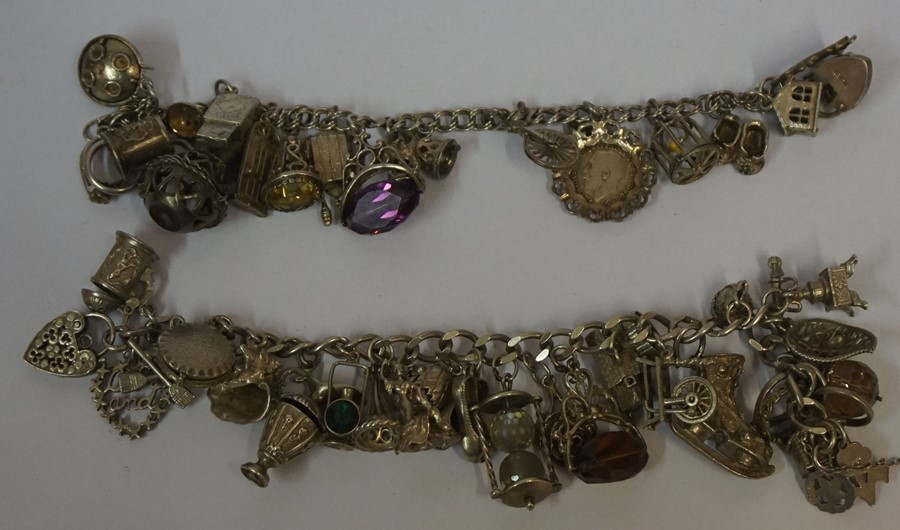 Lot 8 - Two Silver Charm Bracelets, to include charms with gemstones, overall weight 157 grams, (2)