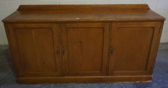 Victorian Stained Pine Cupboard, Having three doors, 99cm high, 183cm wide, 41cm deep
