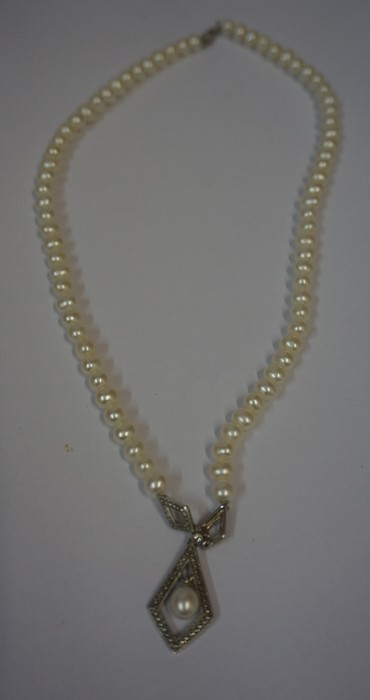 Lot 1 - Cultured Pearl Necklace, with a silver, marcasite and pearl pendant drop, Having a silver clasp,