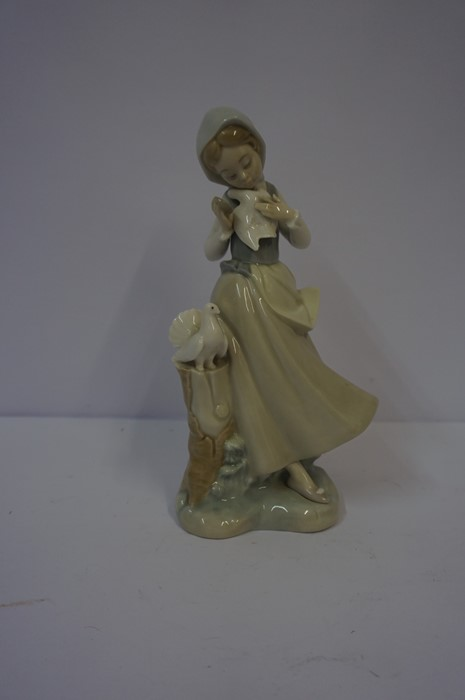 Lot 29 - Two Porcelain Figure Groups by Lladro, Comprising of three winged cherubs with hymn book, and a girl
