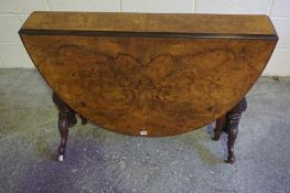 Victorian Burr Walnut Sutherland Table, Having drop leaves, raised on turned supports and scroll