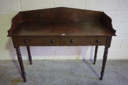 A Late Georgian Mahogany Washstand, Having a three quarter gallery to the top, above two small