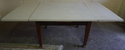 A Vintage Mahogany Pull Out Dining Table, Having a later laminate top, 76cm high, 121cm wide